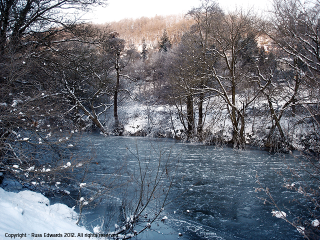 A view of the frozen river looking across to Dolerw Park - Newtown
